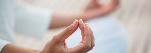 Closeup photo of woman's hands in yoga pose