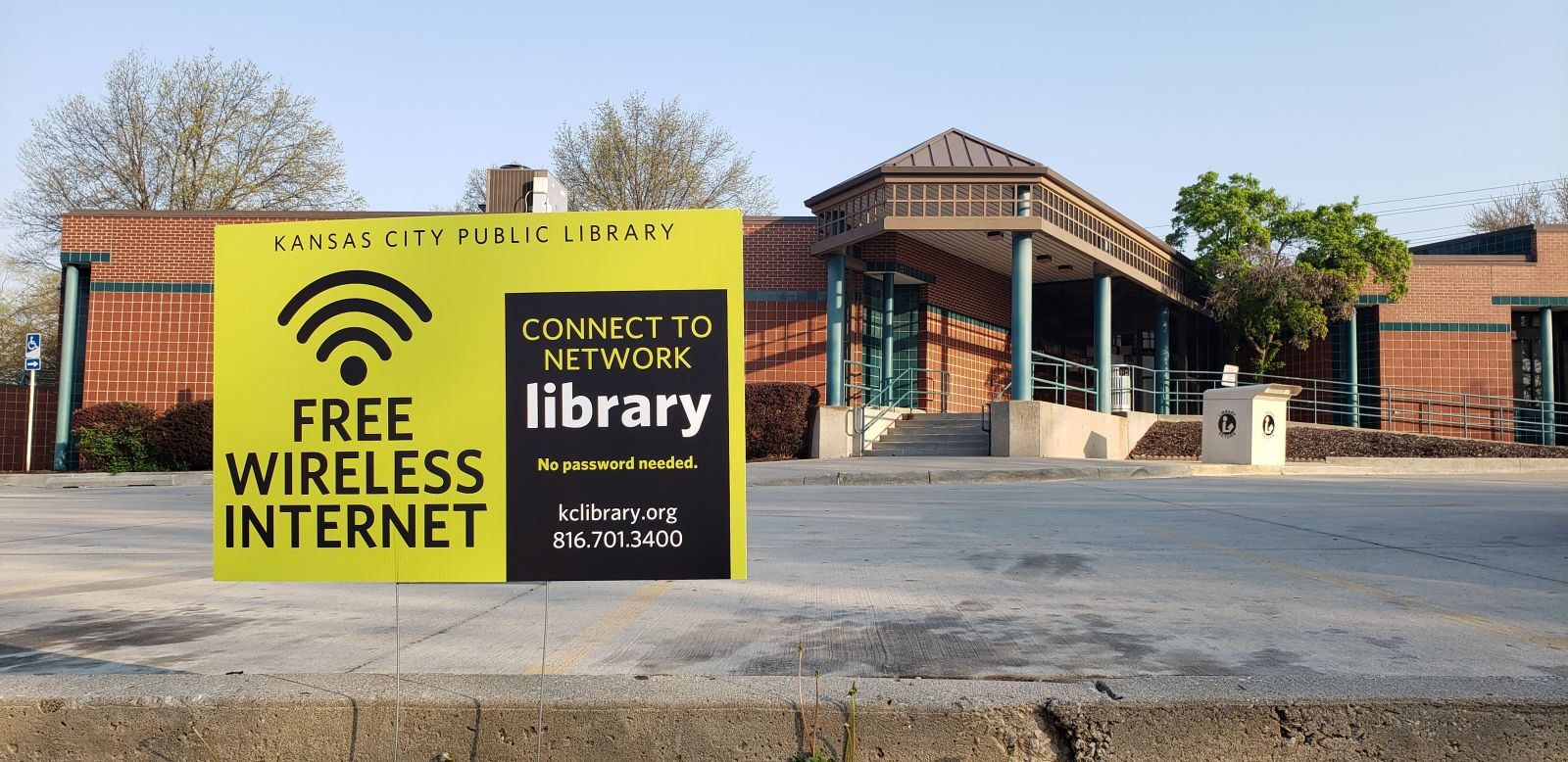 Image of WiFi yard signs at Library location