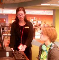 Anna Francesca helps Rachel search the electronic catalog.