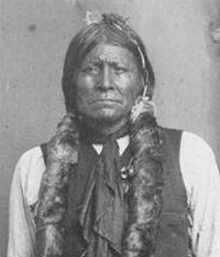 Apache chief Dor-con-each-la in traditional dress