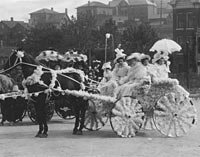 Women in formal dress in horse-drawn carriage