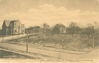 Postcard of an Independence street scene and the Temple Lot, dedicated by Joseph Smith, Aug. 3, 1831