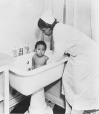 Bathing her baby, Florence Home for Colored Girls, Kansas City, Missouri
