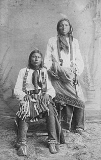 Studio portrait of two Comanche men, ca. 1890. Lenny & Sawyers Indian Views, Purcell, I.T.
