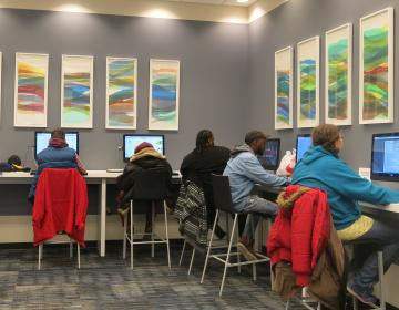 A sequence of 10 relief prints by KCAI associate professor Laura Berman overlooks a nearby bank of computer stations in ONENORTH.