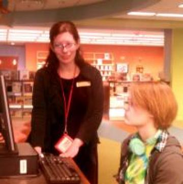Anna Francesca helps Rachel search the electronic catalog.