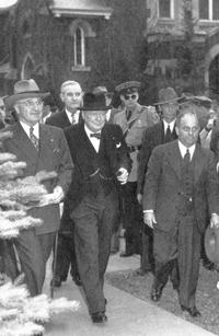 Westminster College President Franc L. McCluer (far right) leads Harry S. Truman (far left) and Winston Churchill (center) on a tour of campus.