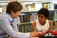 Volunteer Renee VanErp shares the Joy of Reading with 10-year-old Parijat Mondal in the Plaza Kids' Corner.