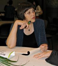 Donna Trussell prepares to sign her book at the Thorpe Menn Award at the Kansas City Library.