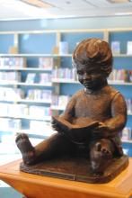 Child Reading on Pedestal